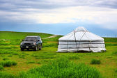 Jeep parked next to yurt — Stock Photo