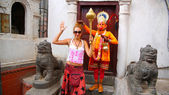 Man wearing Hanuman costume and tourist girl — Stock Photo
