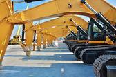 Caterpillars, Yellow heavy construction work vehicles, parking — Stock Photo