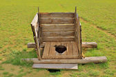 Mongolian wooden squat toilet — Stock Photo