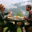 Tourist couple eating breakfast — Stock Video