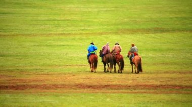 People riding horses in Mongolian landscape — Stock Video