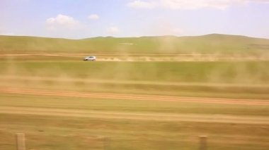 Cars going vast grassland of mongolia — Stock Video