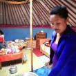 Stock Video: Mongolian people drying Meet inside ger camp