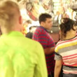 Tourists in traditional street market — Stock Video #39237301