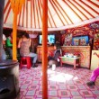 Stock Video: Mongolian family inside yurt
