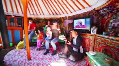 Mongolian family inside yurt — Stock Video