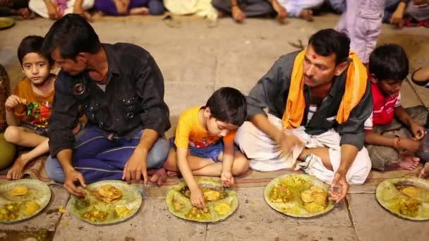 People eating free food at street — Stock Video ...