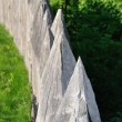 Stock Photo: Sharp wooden paling as part of old fort