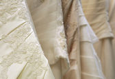 Detail of bridal gowns — Stock Photo