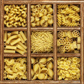 Different kinds of italian pasta in wooden box catalog — Stock Photo