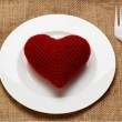 Red heart in plate with knife and fork — Stock Photo