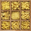 Royalty-Free Stock Photo: Different kinds of italian pasta in wooden box catalog