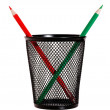 Red and green pencils in black pencil holder - Stock Photo