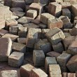 Thrown beige pavement blocks — Stock Photo