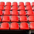 Regular red seats in a stadium — Stock Photo