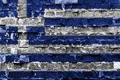 レンガの壁にギリシャの国旗 — ストック写真