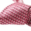 Pink tie know cliseup. isolated on white background — Stock Photo
