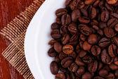 Plate with with coffee beans — Zdjęcie stockowe