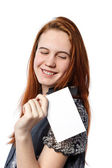 Young happy woman holding big white card — Stock Photo