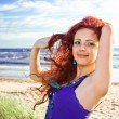 Young woman on a beach — Stock Photo #17001155
