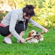 Woman and dog on a lawn — Stock Photo #19566633