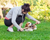 Woman and dog on a lawn — Stock Photo