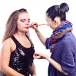 Постер, плакат: Make up artist applying make up on actress