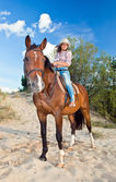 Girl with horse in forest — Stock Photo