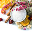 Sea salt with dried fruits, plants and flowers — Stock Photo