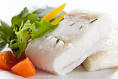Halibut with greens — Stock Photo