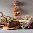 Smoked meat with rosemary — Stock Photo #26521059
