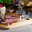 Vodka and smoked meat  — Stock Photo
