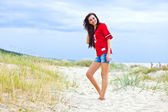 Beauty with long hair on sea beach — Stock Photo