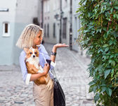 Woman with dog in old city — Stock Photo
