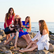 Four girls on seacoast — Stock Photo