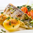 Baked fish with potatoes — Stock Photo