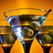 Glasses with martini and green olives — Stock Photo #31362867