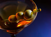 Martini with green olives — Stock Photo