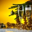 glasses with champagne and Christmas ornaments — Стоковая фотография