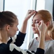 Stylist does a make-up — Stok fotoğraf