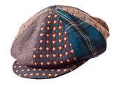 Checkered cap on white — Stock Photo
