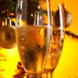 Glasses with champagne and Christmas ornaments — 图库照片