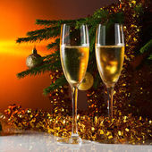 Glasses with champagne and Christmas tree — Stock Photo