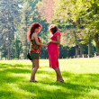 Pregnant woman talks to the girlfriend — Stok fotoğraf