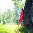 young pregnant woman in park — Stockfoto