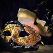 Old gold Venetian masks — Stock Photo