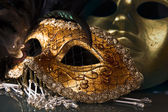 Old gold Venetian masks — Stock Photo