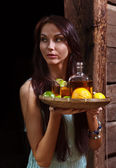 Young beauty with tequila in the old wooden house — Stock Photo