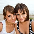 Young girlfriends on a beach — Stock Photo #40347801